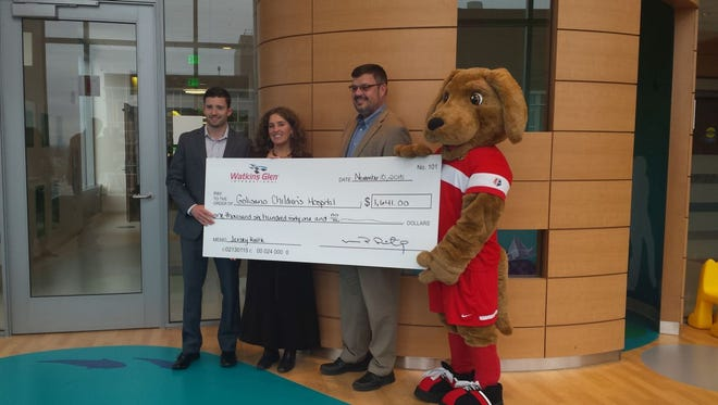 Watkins Glen International Vice President Jon Beckman visits Golisano Children's Hospital in Rochester recently, along with representatives of the Western New York Flash of the National Women's Soccer League and mascot, Striker, with a donation of $1,641. The funds were raised when WGI teamed up with the Flash to raffle game-used jerseys promoting last June's Sahlen's Six Hours of The Glen.