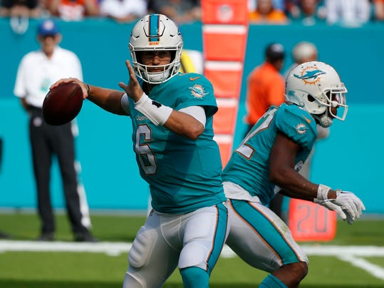 In this Dec. 3, 2017, file photo, Miami Dolphins quarterback Jay Cutler (6) looks to pass during the first half of an NFL football game against the Denver Broncos in Miami Gardens, Fla. New England plays at Miami on Monday night, Dec. 11. (AP Photo/Wilfredo Lee, File)