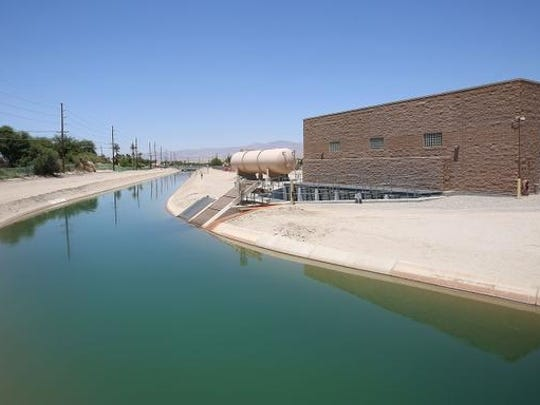 The Coachella Valley Water District's Mid-Valley Pipeline pump station, right, diverts Colorado River water from the Coachella Canal in Indio on June 2, 2015.
