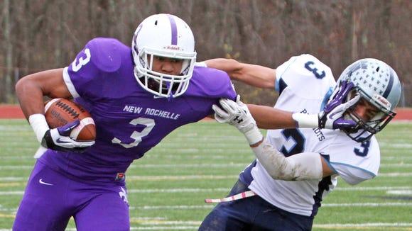 New Rochelle's Jayson Prince stiff arms John Jay East