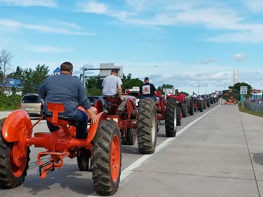 Vintage tractors will parade across the bridge for