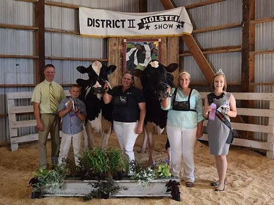 District 2 Grand Champion and Reserve Grand Champion of the Open Show (from left) Judge Ryan Krohlow, Grand Champion Klinkner GW Atwood Sunny, Gail Klinker, Reserve Grand Champion Kiko Mogul Mara 1095, Garrett Schmidt, WHA Princess Courtney Moser.