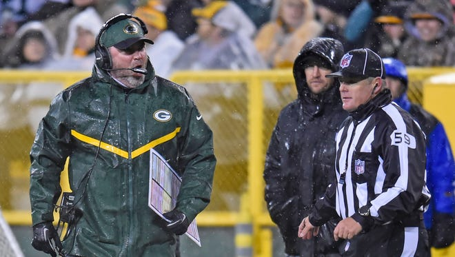 Green Bay Packers head coach Mike McCarthy yells at an official after a play against the Chicago Bears at Lambeau Field November 26, 2015.