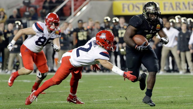 Purdue running back D.J. Knox, right, runs past Arizona cornerback Lorenzo Burns (2) for a touchdown during the first half of the Foster Farms Bowl NCAA college football game Wednesday, Dec. 27, 2017, in Santa Clara, Calif.