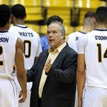 Southern Miss coach Doc Sadler addresses players during a timeout in Thursday's double-overtime loss to UAB at Reed Green Coliseum.