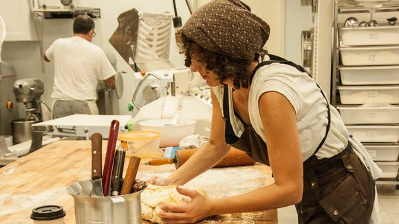 Pastry chef Hannah Ellaham processes dough at ZuHause Bakery at 6774 Johnston St on Lafayette's south side