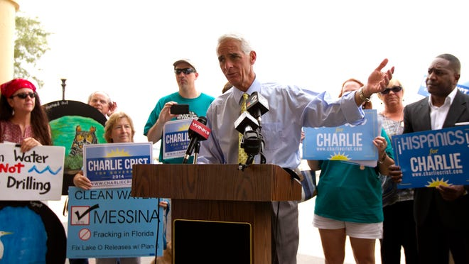 Former governor — and current gubernatorial candidate — Charlie Crist speaks to a small crowd Monday at Centennial Park in downtown Fort Myers.