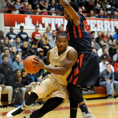 Oakland point guard Kahlil Felder (20) goes to the