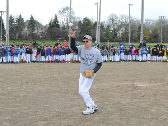 Throwing a first pitch during Saturday's PCLL ceremonies