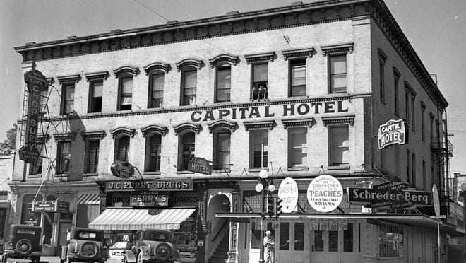 The Murphy Building was constructed in the 1850s and was one of Salem's early brick buildings. Among the businesses seen before its 1940 demolition were the New Shanghai Cafe, advertising chop suey, J.C. Perry Drugs, Capital Hotel and Schreder-Berg grocery.