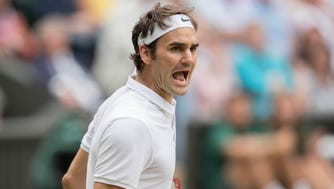 Roger Federer reacts during his match against Milos Raonic.