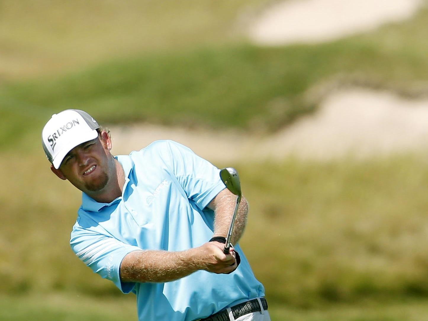 J.B. Holmes hits to the 16th hole during the first round of the PGA Championship golf tournament Thursday, Aug. 13, 2015, at Whistling Straits in Haven, Wis. (AP Photo/Julio Cortez)