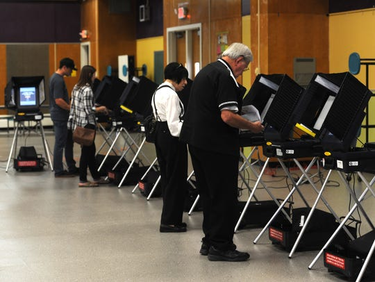 Voters cast their ballots at Hug High School in Reno