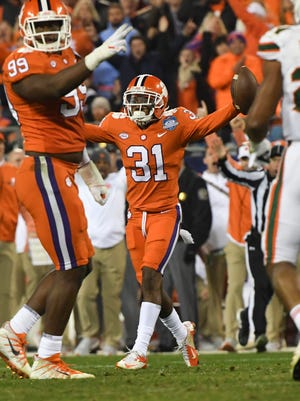 Clemson defensive back Ryan Carter (31)celebrates his interception during the third quarter of the Dr.Pepper ACC football championship in Charlotte on Saturday.
