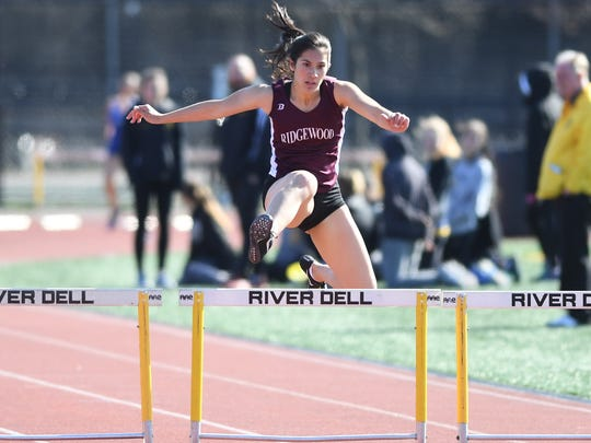 Jack Yockers Bergen County Relays at River Dell High School in Oradell on Friday, April 20, 2018. Katherine Muccio, of Ridgewood, in the 3x400 hurdles.
