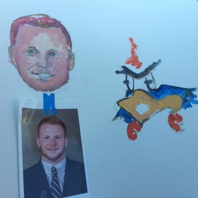 Final touches: Late UD football coach Raymond's last artwork lands in hands of subjects