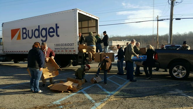 The Town of Poughkeepsie Police Benevolent Association delivered 100 holiday baskets to town residents Friday.