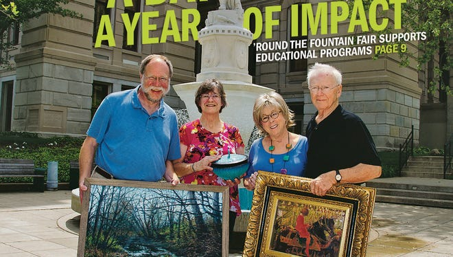 Artist Dennis Wishmeier, left, with his painting, Ellie Haan from Haan Museum, Ruthie Shook and Jim Bodenmiller with Round the Fountain Tuesday, May 20, 2014, outside Tippecanoe County Courthouse in Lafayette.