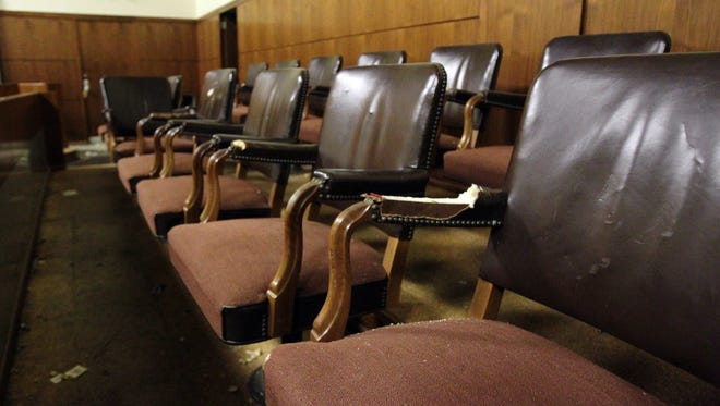 The jury seating area of the main courtroom inside the old Federal Building and U.S. courthouse, which was bought by the City of Lafayette in 2001 after the construction of the John M. Shaw Federal Building, is pictured Tuesday, July 22, 2014, in Lafayette, La.