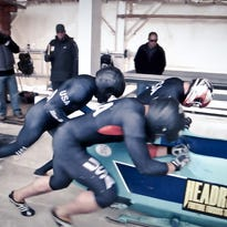 Colin Coughlin rides a two-man bobsled with brakeman Andreas Drbal in Lake Placid in 2013.