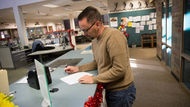Vernon Corley fills in his declaration for candidacy paperwork on Tuesday at the San Juan County Clerk's office in Aztec. Corley is running for a seat on the Farmington Municipal School board.