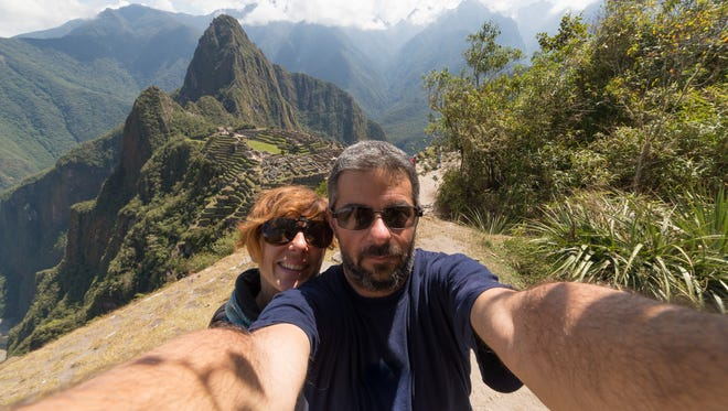 Tourists take a selfie on the terraces above Machu Picchu, the most visited travel destination in Peru.