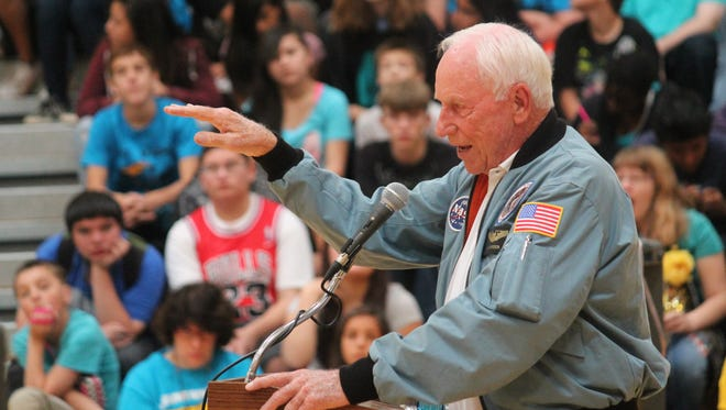 Apollo 15 astronaut Al Worden talks about his experience orbiting the moon to the students at Chaparral Middle School on Friday morning.