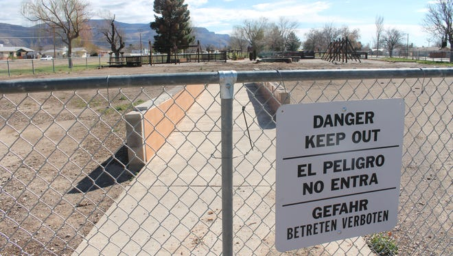 Signs warning residents to keep out of the remnants of Kids Kingdom are posted on each of the park. The City of Alamogordo announced Tuesday night that their insurance had concluded their investigation and is prepared to pay an estimated $450,000 for the loss of the beloved community playground.