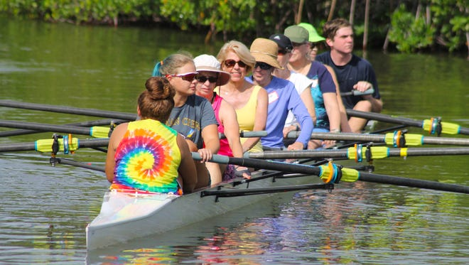 Debbie Chastain, center in yellow, on the water.