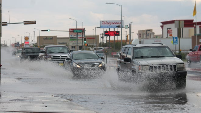 Alamogordo was hit with heavy rainfall Monday afternoon. White Sands Boulevard and 10th Street temporarily flooded due to the heavy down pour.