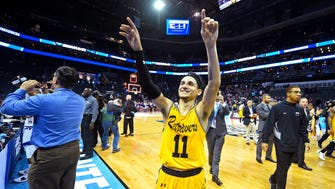 Mar 18, 2018: UMBC Retrievers guard K.J. Maura (11) waves to fans after losing to the Kansas State Wildcats in the second round of the 2018 NCAA Tournament at Spectrum Center.
