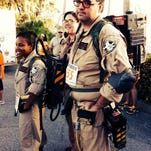 Ron and Leah Lowe and Jackie Lewis dressed as Ghostbusters at a previous Ghostly Gecko 5K.