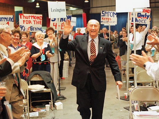 Sen. Strom Thurmond, R-S.C., waves as he's applauded on the way to speaking at the South Carolina Republican Party state convention May 4, 1996, in Columbia, S.C. Thurmond who is retiring after serving 48 years in the U.S.  Senate will celebrate his 100th birthday Dec. 5, 2002.