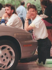 1996: Walter Wolanyk of Newark, left, leans on his chin as Dennis Bunch of Rochester, right, props his head in his hand during the 18th hour of the Kidney foundation Touch-a-Thon at Marketplace Mall.
