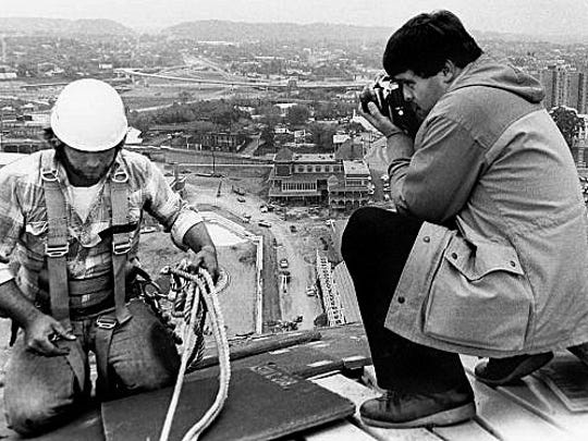 Michael Patrick takes a photo of Donnie Cusick, from Seymour, while he is working on installing sheets of sheet metal 260 feet above ground on the top of the Sunsphere on October 23, 1981. Photo by Michael Patrick