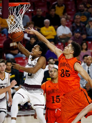 Arizona State guard Tra Holder, left, drives past Idaho State forward Kyle Ingram (35) and guard Brandon Boyd (15) during the second half of an NCAA basketball game Friday, Nov. 10, 2017, in Tempe, Ariz.