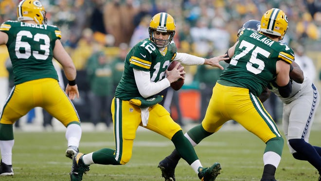 Green Bay Packers quarterback Aaron Rodgers (12) changes direction in the pocket in the first quarter against the Seattle Seahawks as the Green Bay Packers host the Seattle Seahawks on Sunday, December 11, 2016, at Lambeau Field in Green Bay, Wis.