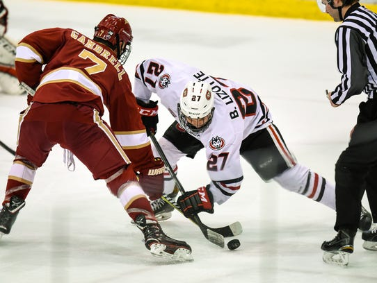 St. Cloud State's Blake Lizotte takes the faceoff during