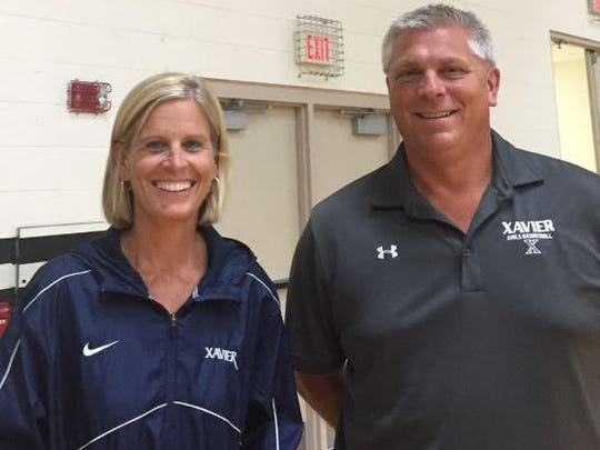 Kate Geenen and Brian Paschen will be co-head coaches for the Xavier girls' basketball team this season.
