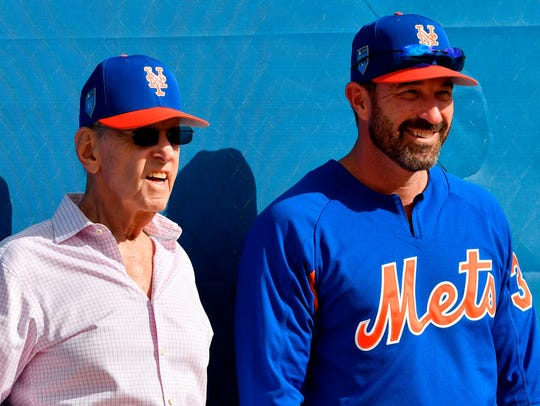 New York Mets owner Fred Wilpon (left) talks with manager Mickey Callaway (right) during practice drills at First Data Field.