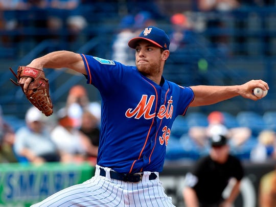 Steven Matz throws a pitch during spring training.