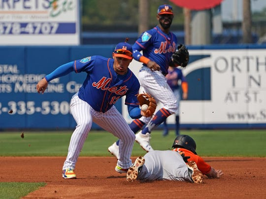Asdrubal Cabrera makes a tag during a spring training game.