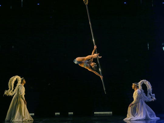 Stephanie Ortega performs a suspended pole act during