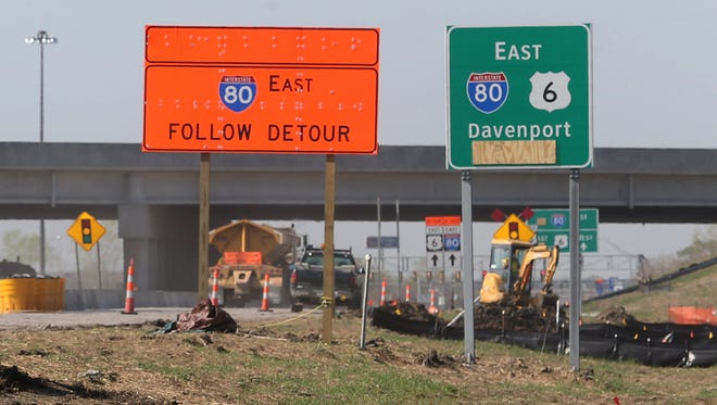 Signs guide drivers through a construction zone in Altoona.