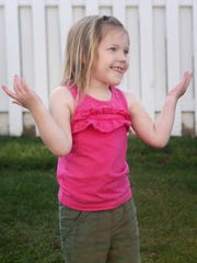 Addyson, 4, plays in the backyard of her Colorado home.