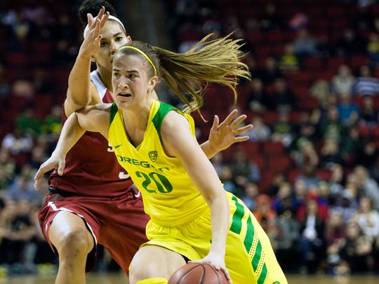 Mar 4, 2018; Seattle, WA, USA; Oregon Ducks guard Sabrina Ionescu (20) drives past Stanford Cardinal forward Kaylee Johnson (5) during the first half during the championship game of the Pac-12 Women's Basketball Tournament at KeyArena. Mandatory Credit: Troy Wayrynen-USA TODAY Sports