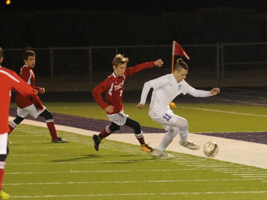 Wylie's Peyton Wood (11) turns up field around a pair of Amarillo Tascosa defenders during the 2-0 win on Friday, Feb. 2, 2018.