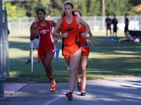 Lely's Rosie Poling races during Friday morning's District 2A-12 meet at Lely High School.