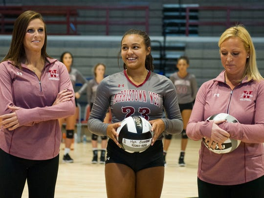 Morristown West's Mya Summers stands between her coaches after receiving awards for breaking two school volleyball records before a game against King's Academy at Morristown West Thursday, Sept. 14, 2017.