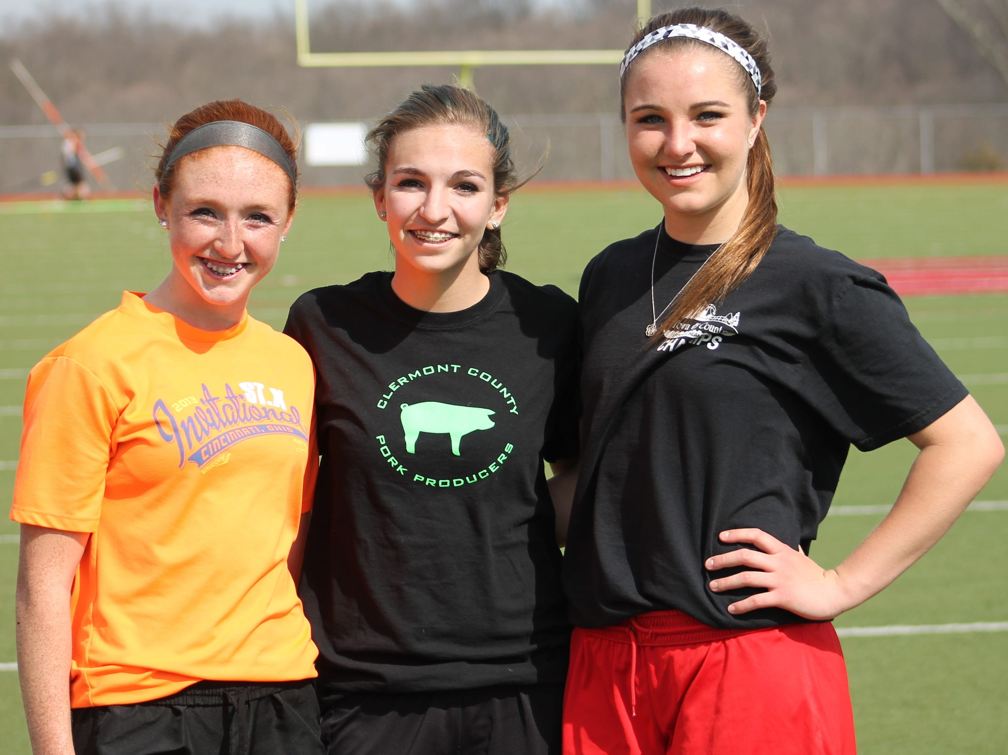 Junior Claire Burns, sophomore Shelbi Simpson and junior Maren Hance are distance specialists for the New Richmond girls track team.